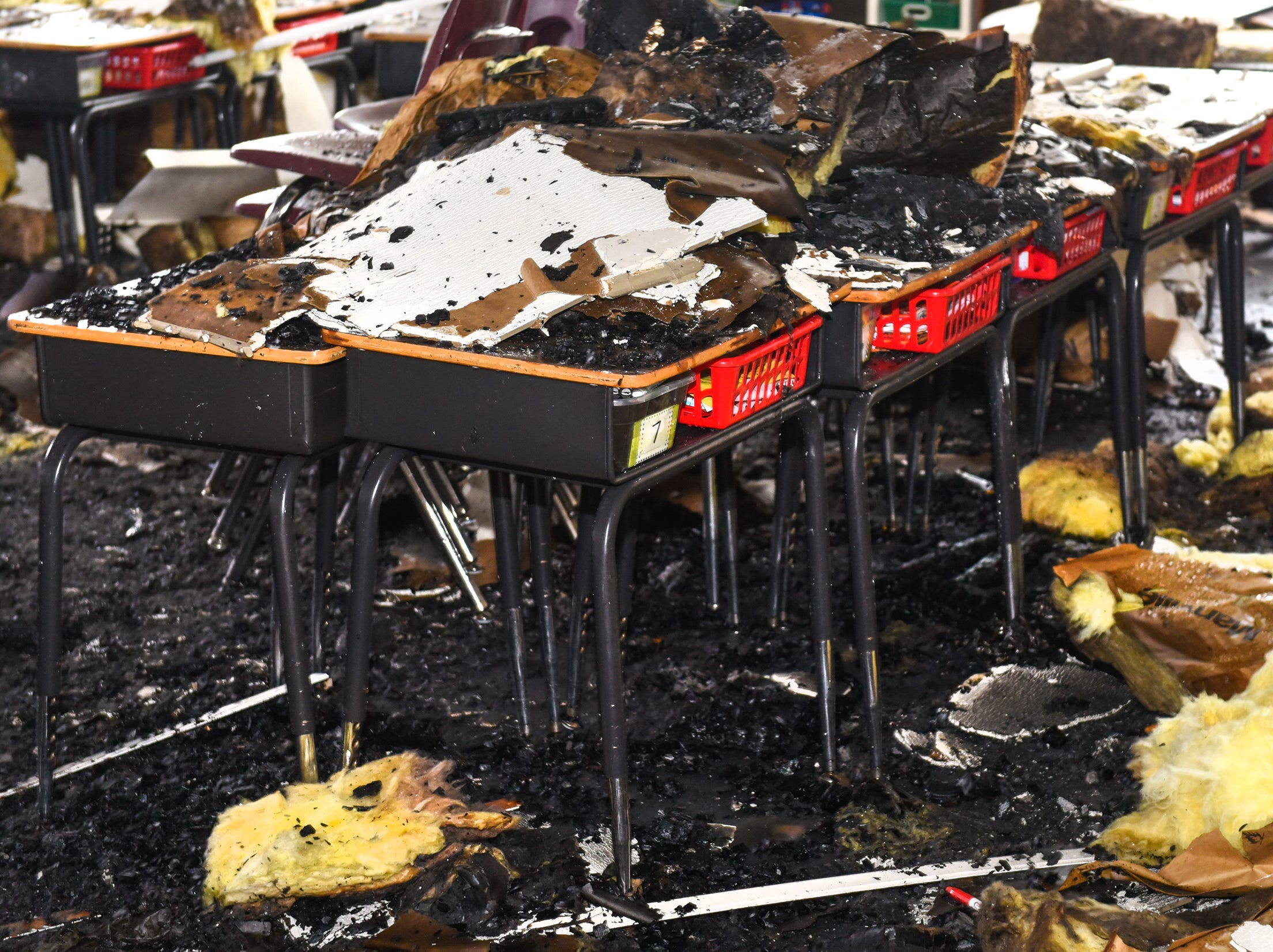 Damaged desks in a classroom at Pleasantview Elementary School shown Monday, Jan. 14, after a fire Sunday night in Sauk Rapids.