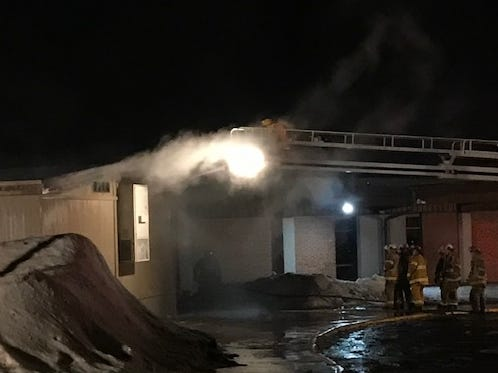 Sauk Rapids fire crews sprayed water into the peak of the roof of a portable classroom Sunday night at Pleasantview Elementary School.