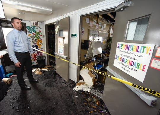 Sauk Rapids-Rice Superintendent Aaron Sinclair looks at the fire damage to Pleasantview Elementary School Monday, Jan. 14, after a fire Sunday night in Sauk Rapids.