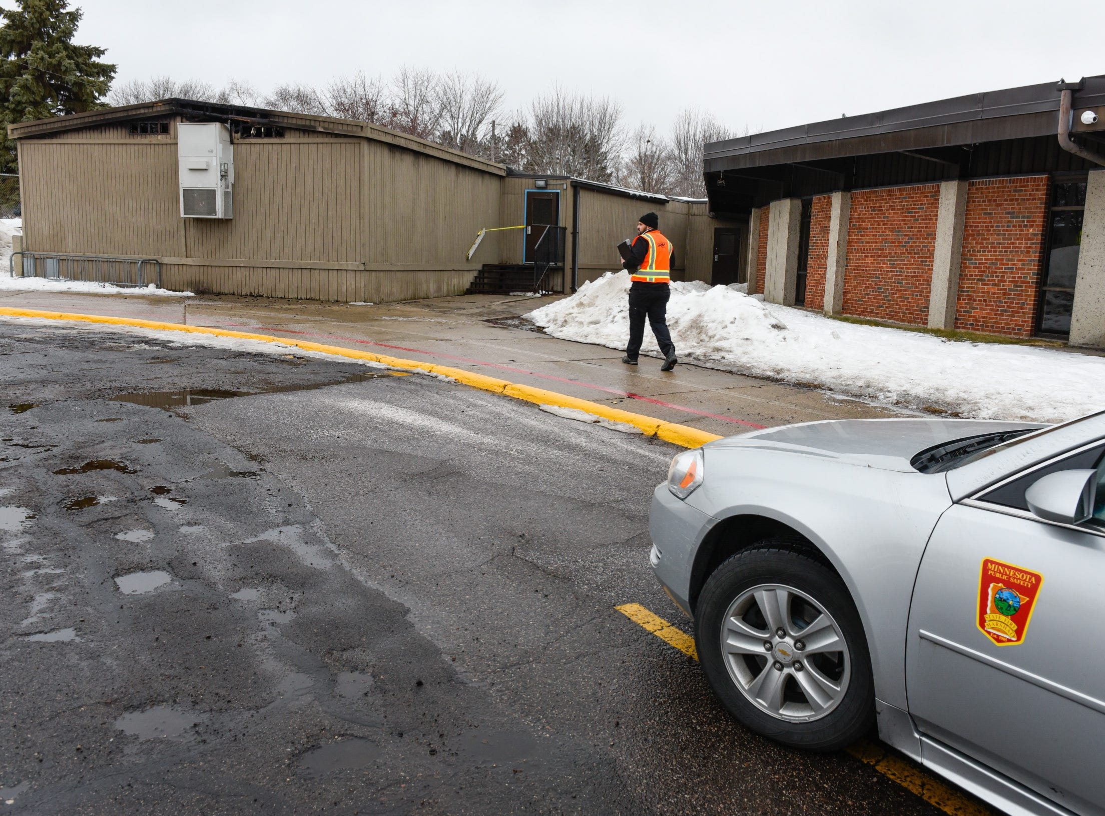 The State Fire Marshal and other officials at Pleasantview Elementary School in Sauk Rapids assessing damage Monday, Jan. 14, after a fire Sunday night.