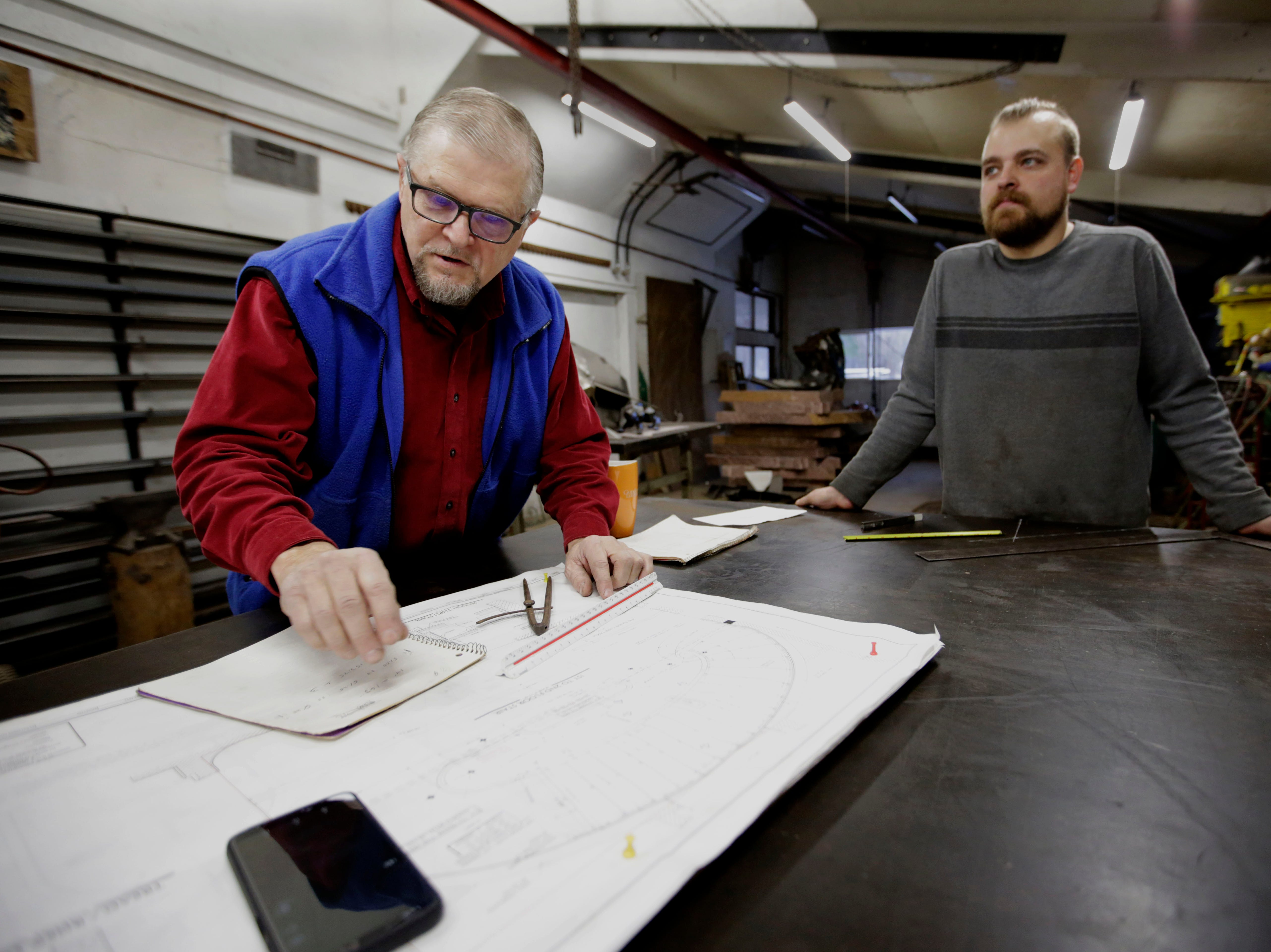 Boleslaw and Vincent Kochanowski go over designs for a private project on Wednesday, December 5, 2018, at their workshop in Junction City, Wis. Tork Mason/USA Today NETWORK-Wisconsin