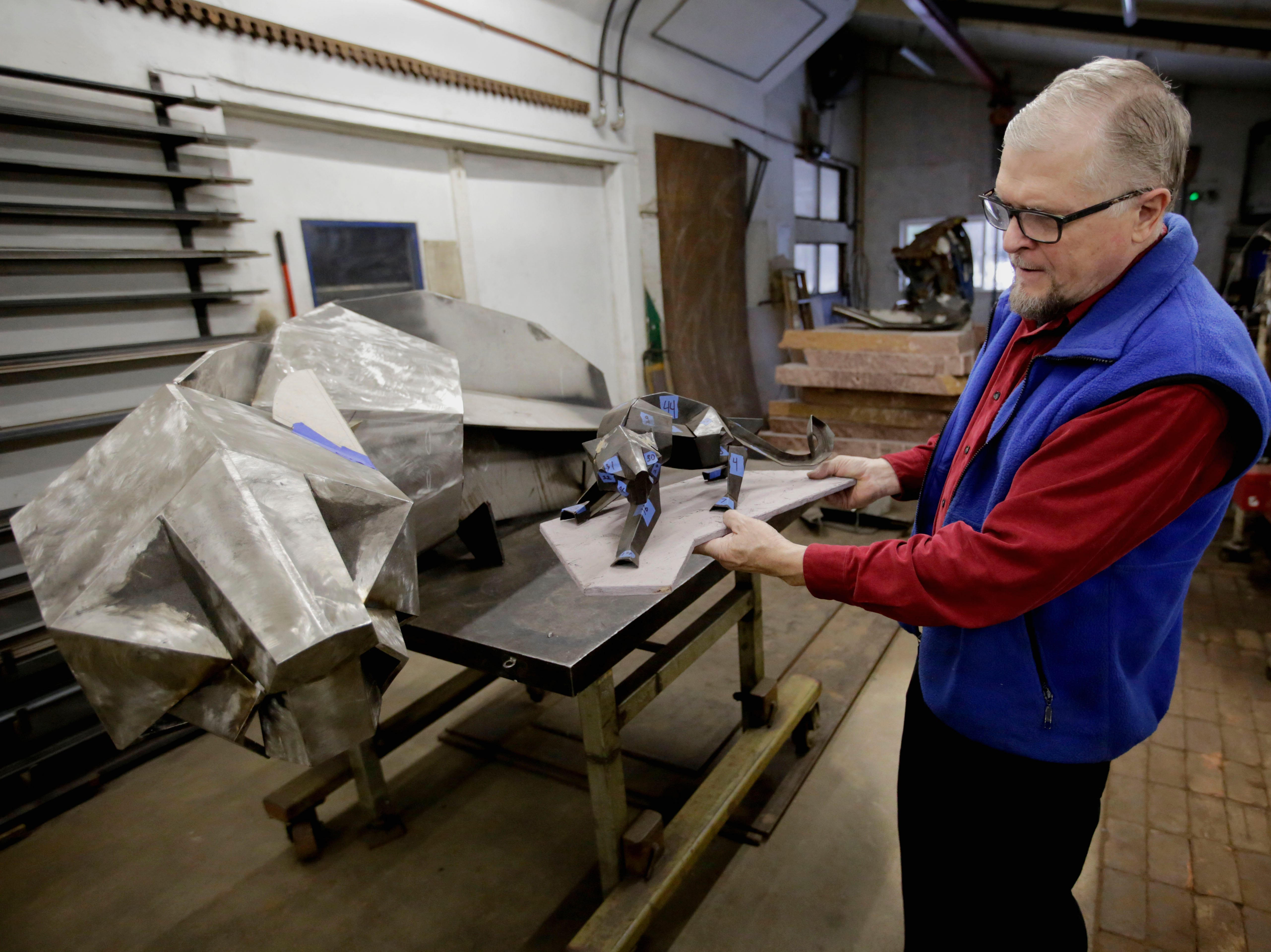 Boleslaw Kochanowski presents a maquette of the SPASH Panther sculpture on Wednesday, December 5, 2018, at his workshop in Junction City, Wis. The piece, once completed, will be installed at SPASH. Tork Mason/USA Today NETWORK-Wisconsin