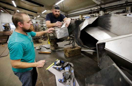 Vincent Kochanowski and August Kochanowski take measurements on their SPASH Panther sculpture on Tuesday, December 25, 2018, at Boleslaw Kochanowski's workshop in Junction City, Wis. The sculpture will be installed at SPASH upon completion.Tork Mason/USA TODAY NETWORK-Wisconsin