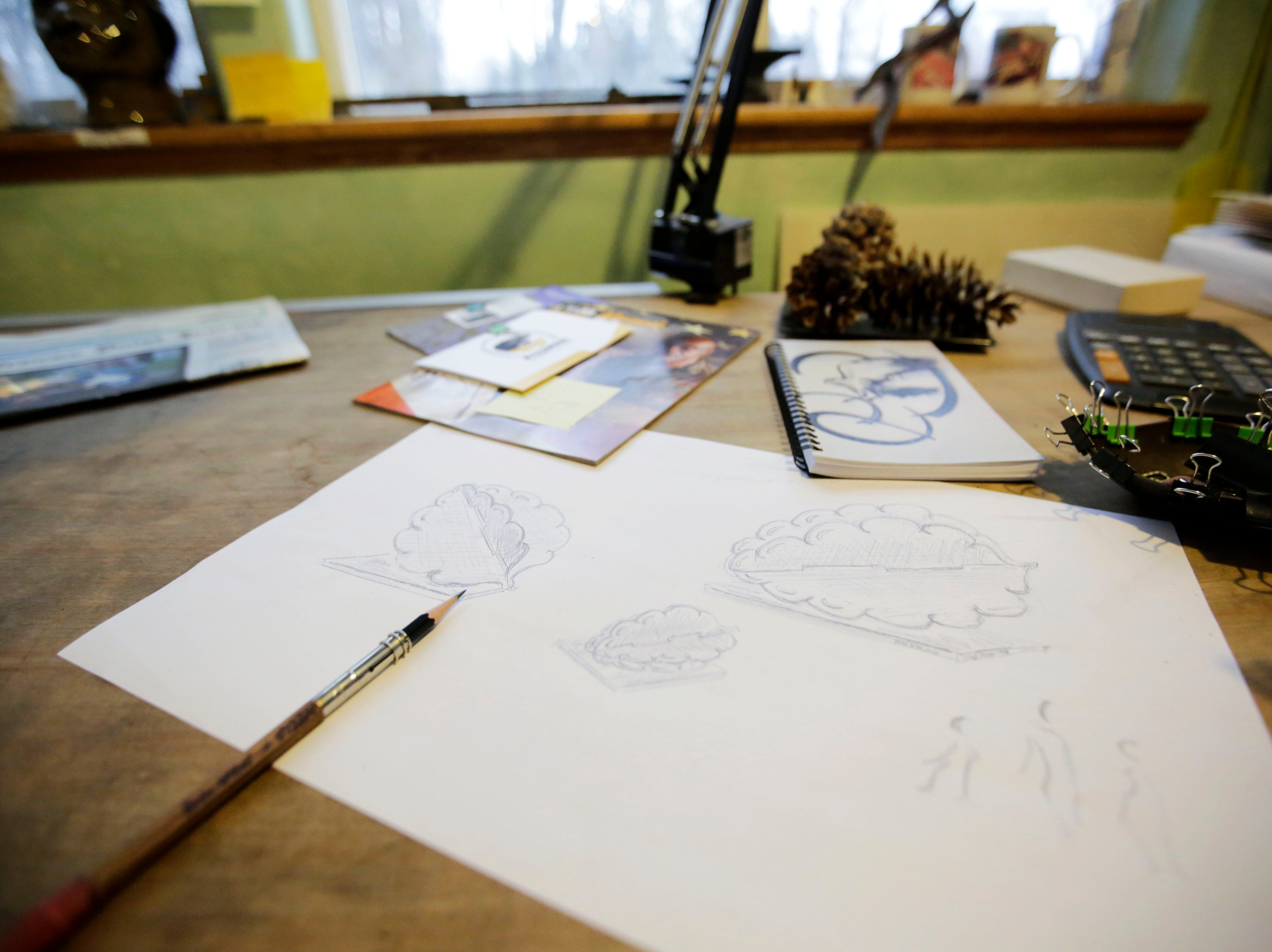 Sketches of pine cone sculptures lie on Boleslaw Kochanowski's work bench on Wednesday, December 5, 2018, at his workshop in Junction City, Wis. The sculptures, inspired by the Polish art form of Wycinanki, will eventually be installed near the roundabout at the intersection of Division Street and North Point Drive. Tork Mason/USA Today NETWORK-Wisconsin