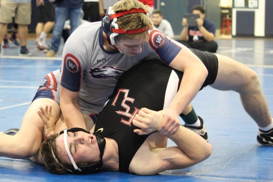 Wakulla's Cole Baggett wrestles Florida High's Noah Perdue during last week's District 2-1A dual.