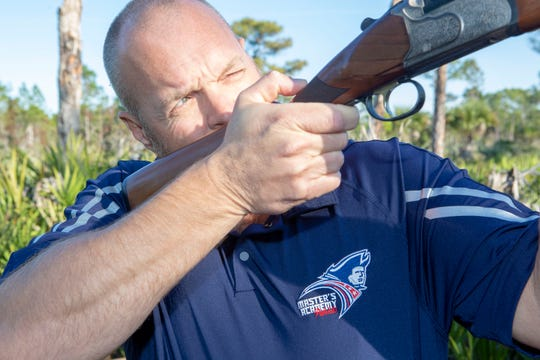 Brian McNeal takes aim at a clay target at the Indian River County Shooting Range.