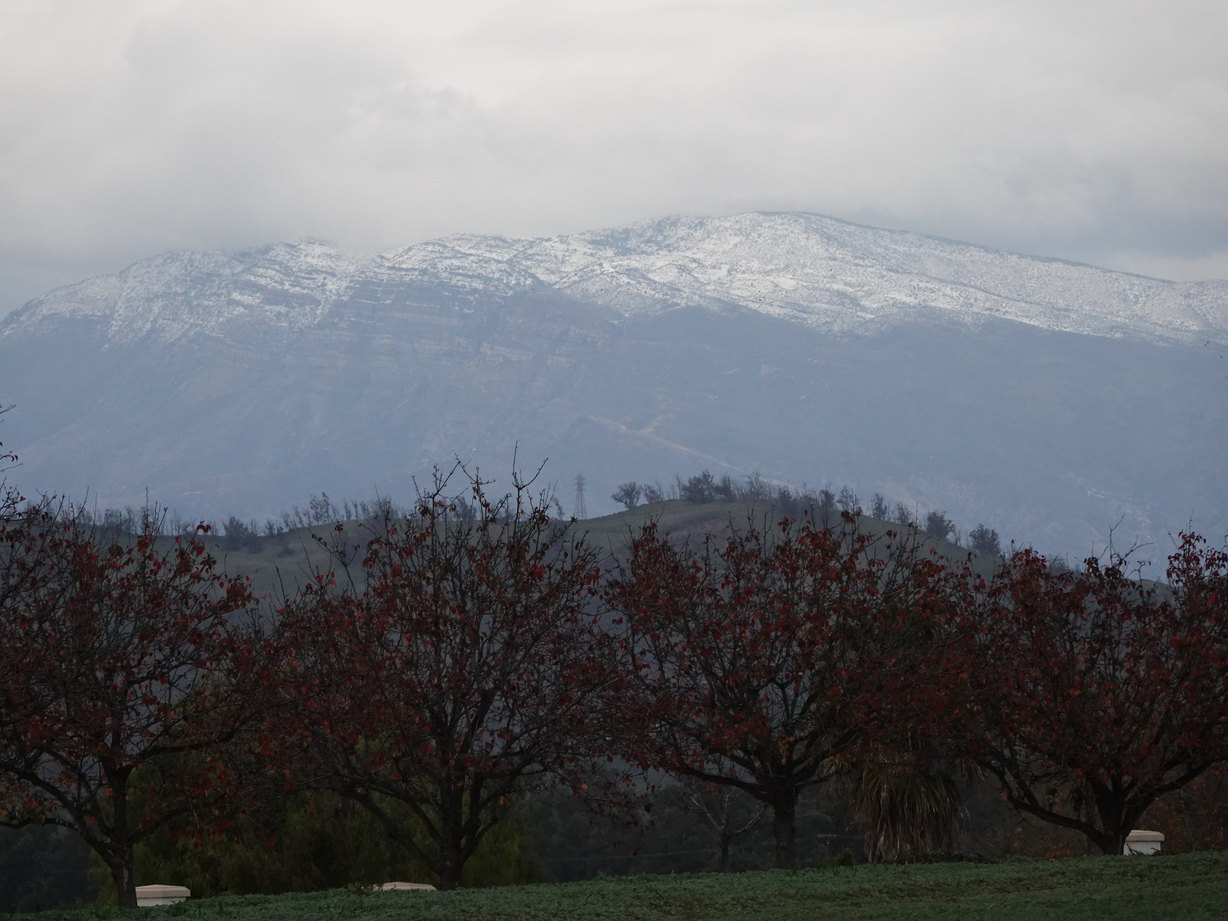 Snow was visible from many parts of Ventura County Sunday, including this view from the outskirts of the Spanish Hills Country Club near Camarillo.