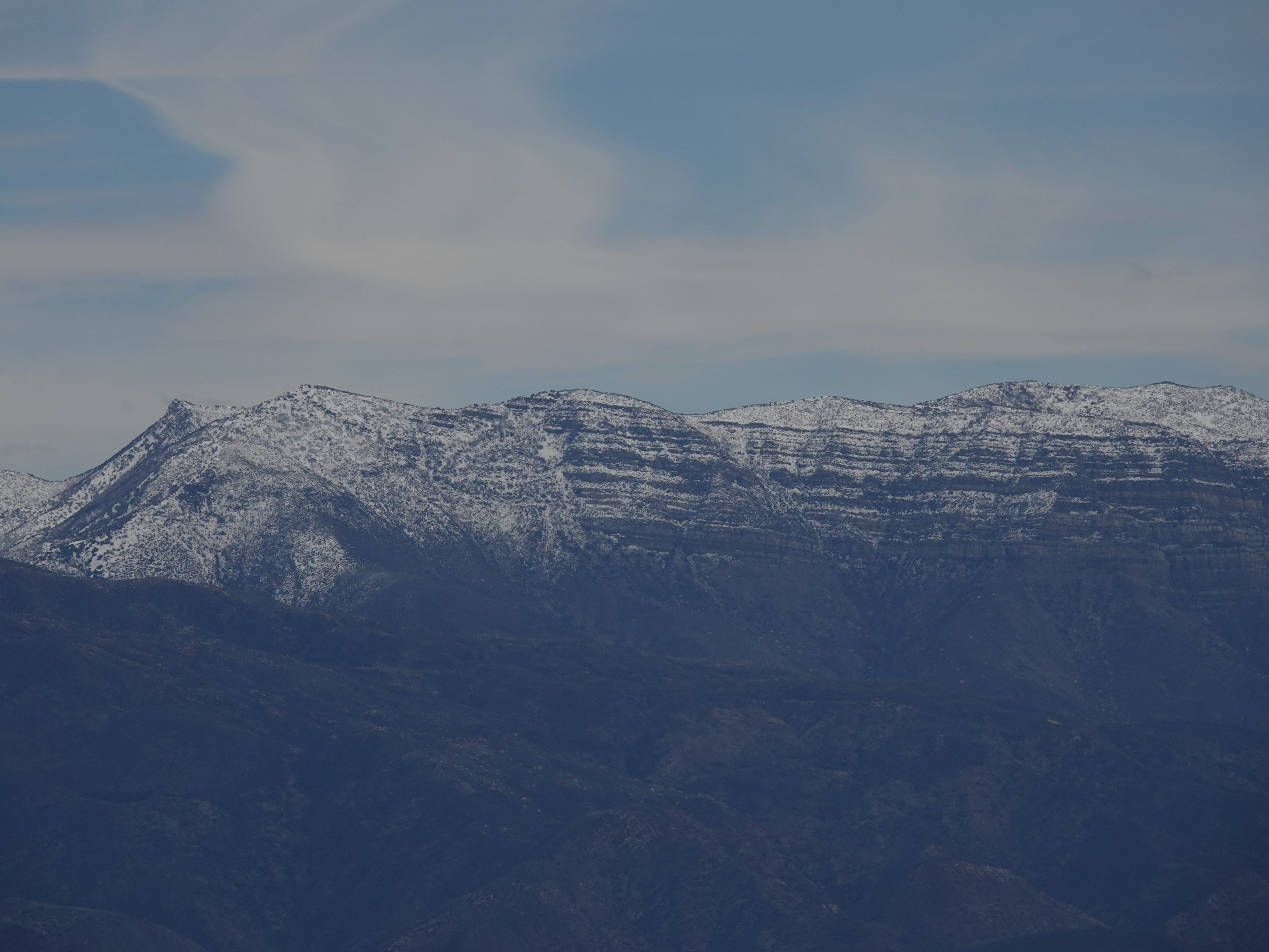 Snow was visible on peaks above Ojai Sunday, as seen here from Highway 150 west of Lake Casitas.