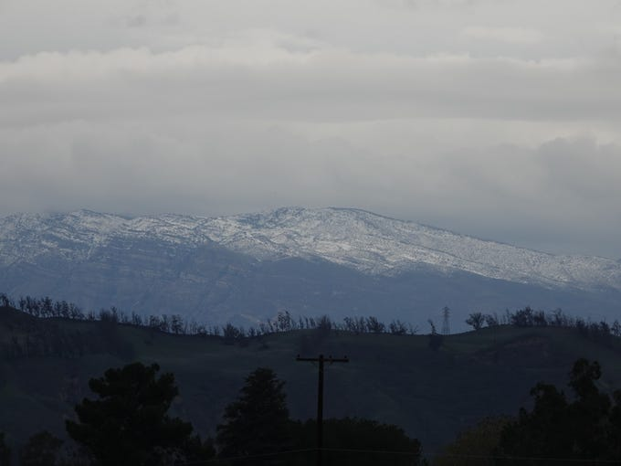 Peaks dusted with snow were visible from many parts of Ventura County Sunday, including agricultural areas west of Camarillo.