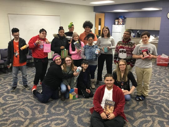Participants pose for a picture during Vineland Public Library's Teen Winter Party.
