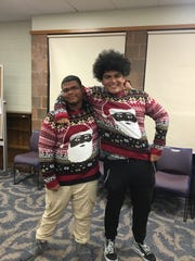 Elijah Oglesby, 15, and Dustin Martinez, 16, show off their holiday sweaters during Vineland Public Library's Teen Winter Party.