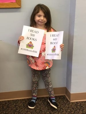 Aria Bertulis, 4, of Millville recently celebrated achieving two reading goals. She reached a goal of 'reading' 500 and then 600 books as part of Cumberland County Library's 1000 Books Before Kindergarten Program. For library information, call (856) 453-2210 or visit www.cclnj.org.
