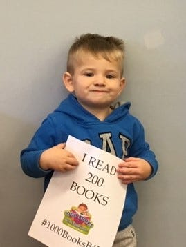 Dean Cramer, 2, of Hopewell recently celebrated a reading achievement. He reached a goal of 'reading' 100 books as part of Cumberland County Library's 1000 Books Before Kindergarten Program. For library information, call (856) 453-2210 or visit www.cclnj.org.