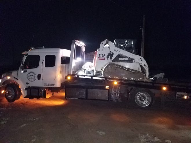 A Tulare couple was arrested after a stolen Bobcat loader was recovered by deputies.
