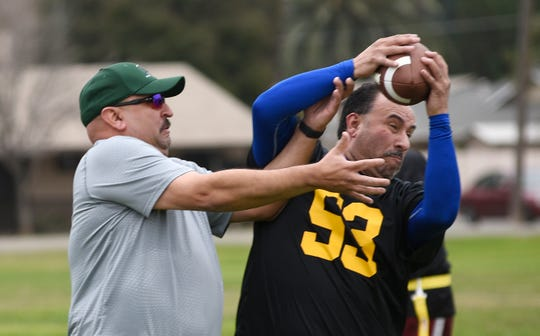 Dep. Jimmy Burciaga, left, and Det. Luis Carrillo go for the ball during a TCSO Road Dawgs practice on Jan. 5, 2018. They are gearing up to face former NFL greats on Jan. 19, 2019 for the Call of Duty kick-off NFL Flag Football game.