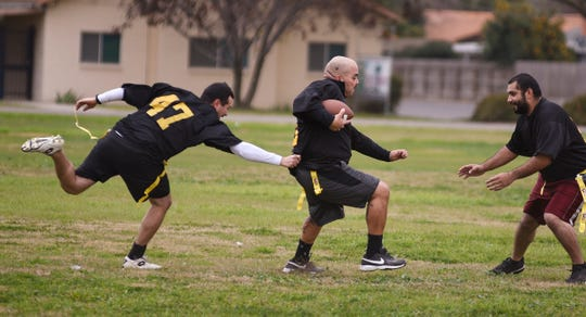 Dep. Jairo Perez, left, Dep. Andy Garcia and Dep. Hector Hernandez practice with the TCSO Road Dawgs on Jan. 5, 2019. They are preparing to face former NFL greats on Jan. 19 at Groppetti Community Stadium as a kick-off to the Sheriff's new NFL Flag Football League, free for boys and girls in grades K-8.