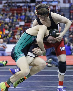 Weyauwega-Fremont senior Cian Fischer, right, remained the top-ranked wrestler at 126 pounds in Division 3 in the fifth state wrestling poll of the season by Wisconsin Wrestling Online.
