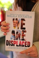 """Girls education activist Malala Yousafzai's new book """"We Are Displaced: My Journey and Stories from Refugee Girls Around the World,"""" Jan. 14, 2019 in the Tappan Zee High School library. Yousafzai, a Nobel Peace Prize winner and victim of a Taliban assassination attempt in Pakistan, visited the district while on tour for her new book."""
