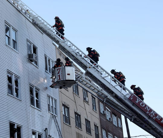 Yonkers firefighters work at the scene of a 3-alarm fire at 295 McLean Avenue in the city, Jan. 14, 2019.