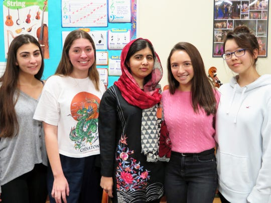 "Girls education activist Malala Yousafzai, center, with Tappan Zee High School Social Justice Club officers from left, senior Erini Kallivokas (treasurer), senior Sarah Cunningham (president), junior Lucy Barsanti (vice president) and junior Hannah Ahn (secretary) during Yousafzai's visit to the middle school Jan. 9, 2019. Yousafzai, a Nobel Peace Prize winner and victim of a Taliban assassination attempt in Pakistan, visited the district while on tour for her new book, ""We Are Displaced: My Journey and Stories from Refugee Girls Around the World."""