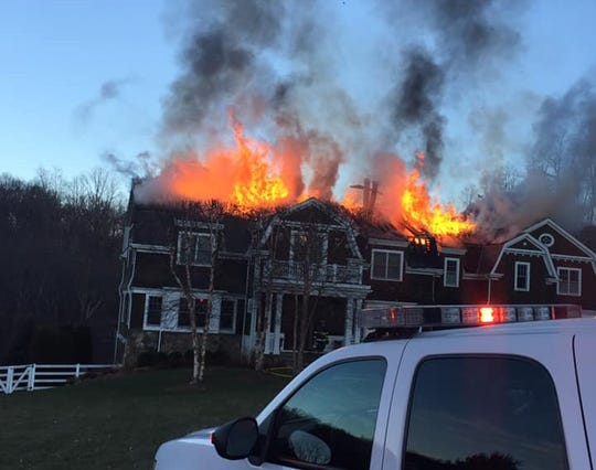 A fire ripped through a house on Sutton Farm Drive in Chappaqua on Jan. 13, 2019.