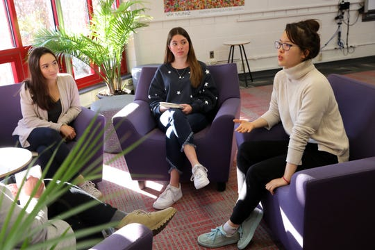 """Social Justice Club vice president Lucy Barsanti, left, president Sarah Cunningham and secretary Hannah Ahn discuss meeting girls education activist Malala Yousafzai, Jan. 14, 2019 in the Tappan Zee High School library. Yousafzai, a Nobel Peace Prize winner and victim of a Taliban assassination attempt in Pakistan, visited the district while on tour for her new book, """"We Are Displaced: My Journey and Stories from Refugee Girls Around the World."""""""