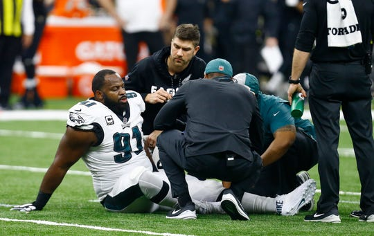 Eagles defensive tackle Fletcher Cox (91) is helped after an injury against the New Orleans, Sunday, Jan. 13, 2019.