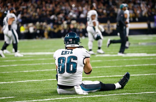 Philadelphia Eagles tight end Zach Ertz (86) sits on the turf after the New Orleans Saints intercepted a pass in the second half of an NFL divisional playoff football game in New Orleans, Sunday, Jan. 13, 2019. The Saints won 20-14. (AP Photo/Butch Dill)