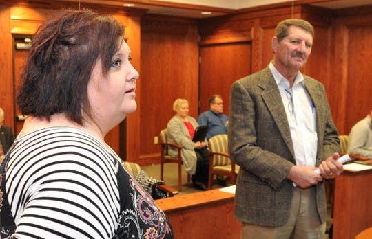 Katrena Mitchell, left, and David Graf speak to the Wichita County Commissioners Monday at the regular meeting. Graf announced that Mitchell was chosen as the new Wichita County Agricultural Extension 4-H Agent.