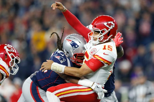 Kansas City Chiefs quarterback Patrick Mahomes (15) is tackled by New England Patriots defensive end Adrian Clayborn (94) after throwing the ball during the fourth quarter at Gillette Stadium.