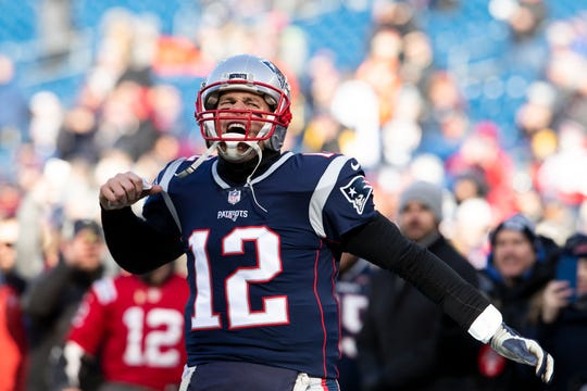 New England Patriots quarterback Tom Brady (12) reacts during warmups before a game against the Los Angeles Chargers in an AFC Divisional playoff football game at Gillette Stadium.