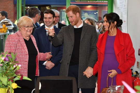 Harry and Meghan arrive to officially open 'Number 7', a 'Feeding Birkenhead' citizens supermarket and community café, on January 14, 2019 in Birkenhead, Merseyside, England.
