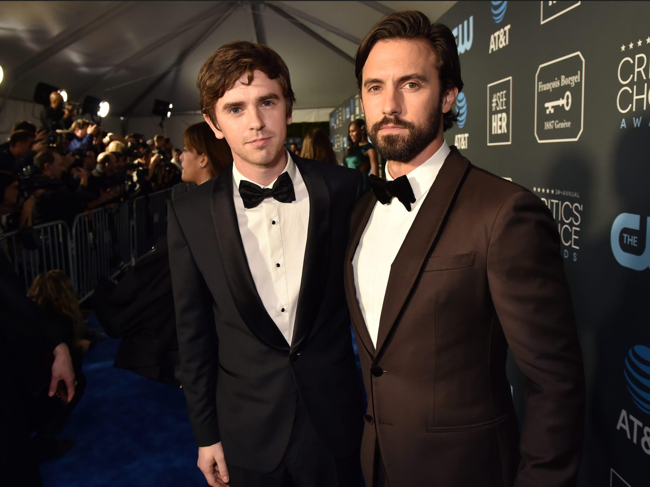 Freddie Highmore (L) and Milo Ventimiglia pose for photographers.