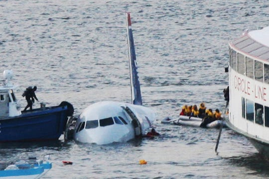 "A diver, left, aboard an NYPD vessel prepares to rescue passengers that escaped from the Airbus 320 US Airways aircraft made an emergency landing in the Hudson River in New York in what came to be known as the ""Miracle on the Hudson"" because everyone survived."
