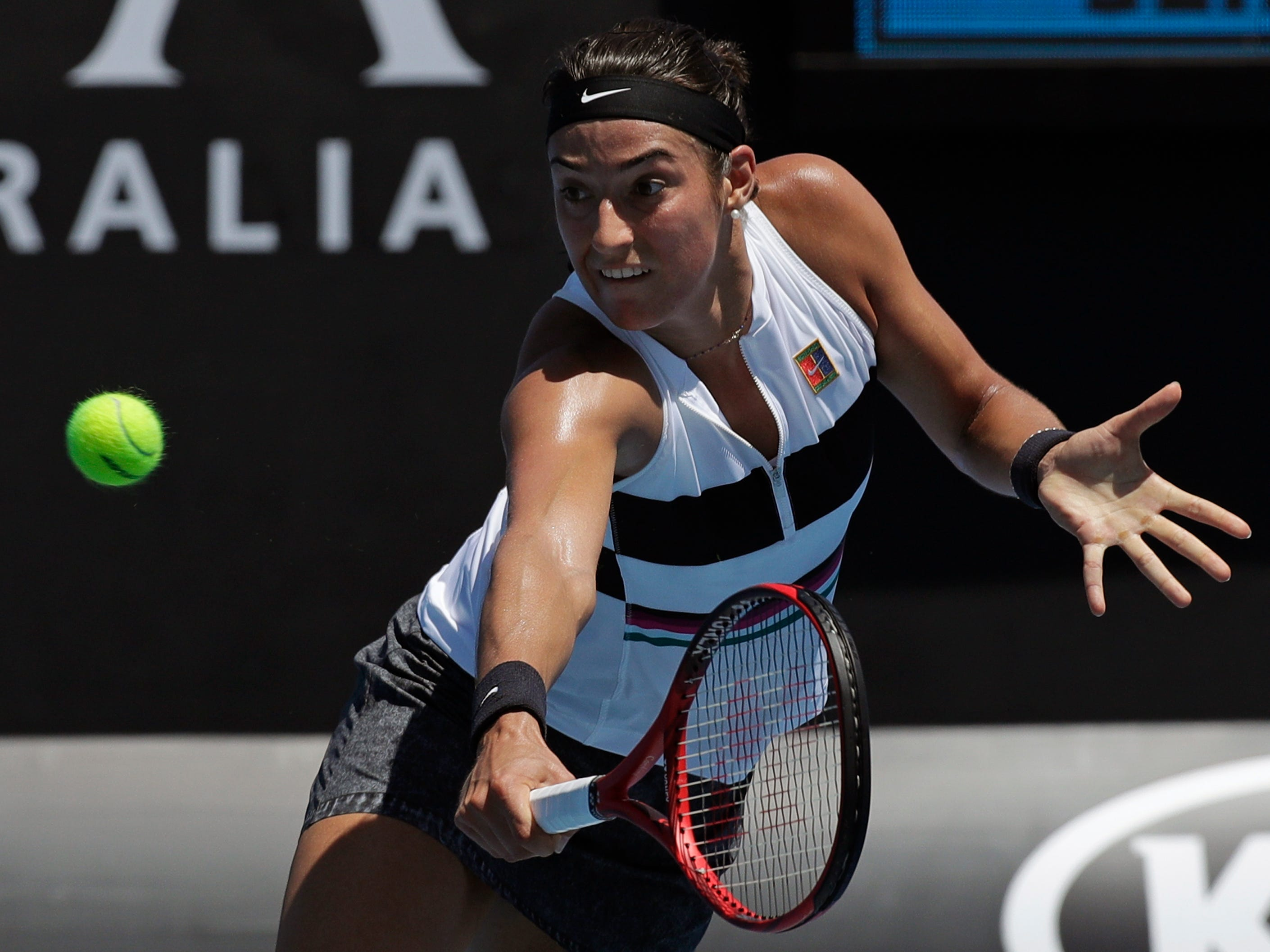 France's Caroline Garcia, the No. 19 seed, plays a backhand to compatriot Jessika Ponchet during her 6-2, 6-3 first-round win.