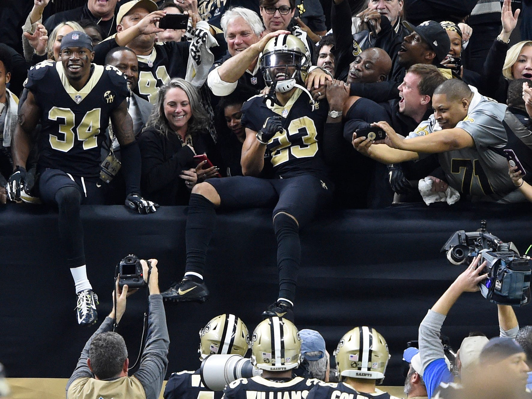 New Orleans Saints cornerback Marshon Lattimore (23) celebrates with fans after intercepting a pass against the Philadelphia Eagles to clinch an NFC divisional playoff win.