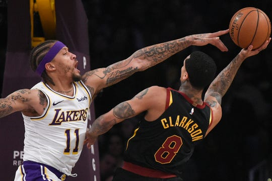 Lakers forward Michael Beasley attempts to block a shot by the Cavaliers' Jordan Clarkson.