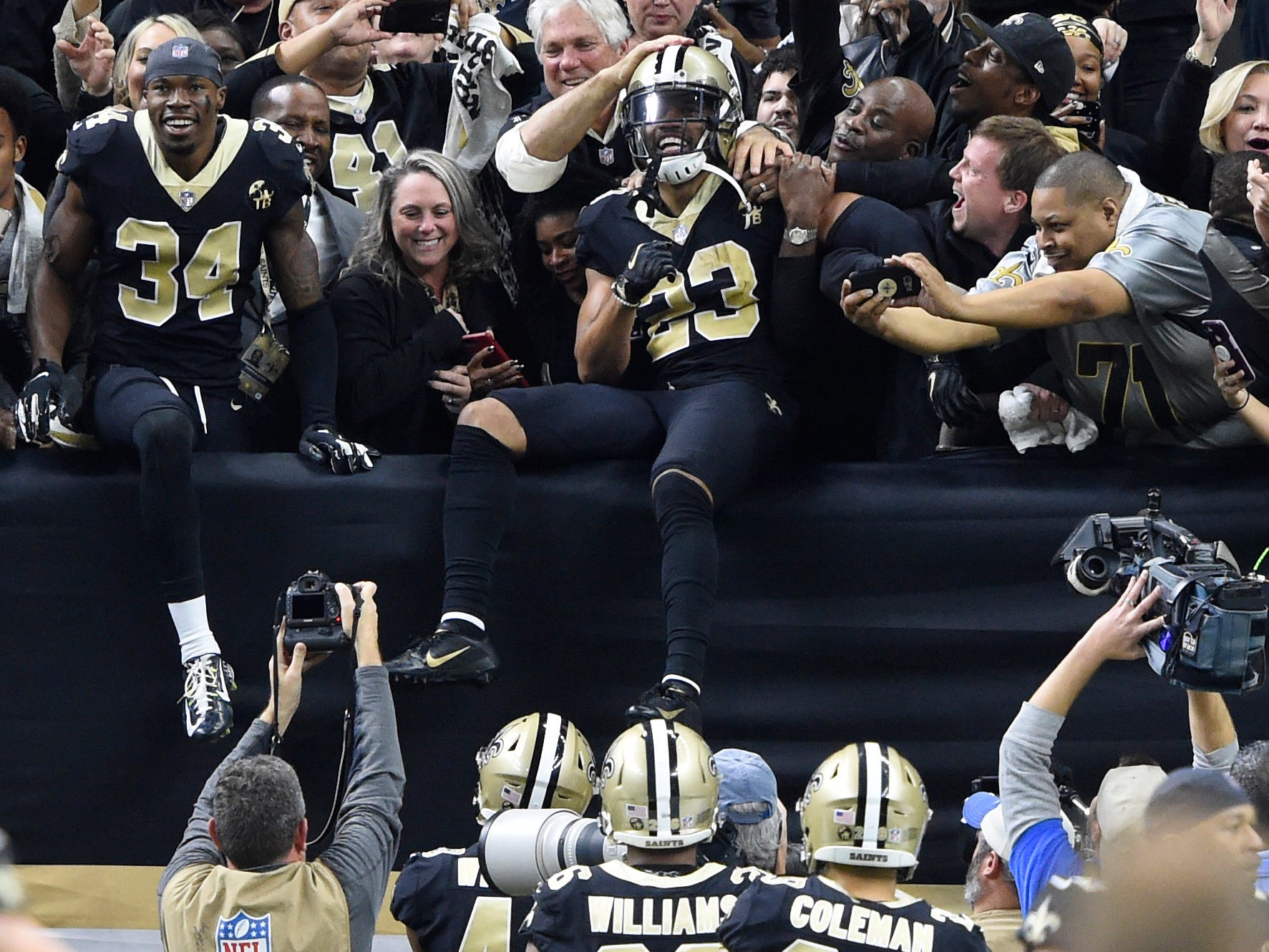New Orleans Saints cornerback Marshon Lattimore (23) celebrates with fans after intercepting a pass against the Philadelphia Eagles during the fourth quarter of the NFC divisional playoff game at Mercedes-Benz Superdome.