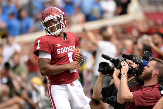 Oklahoma Sooners quarterback Kyler Murray (1) reacts after scoring a touchdown against the UCLA Bruins during the fourth quarter at Gaylord Family - Oklahoma Memorial Stadium.