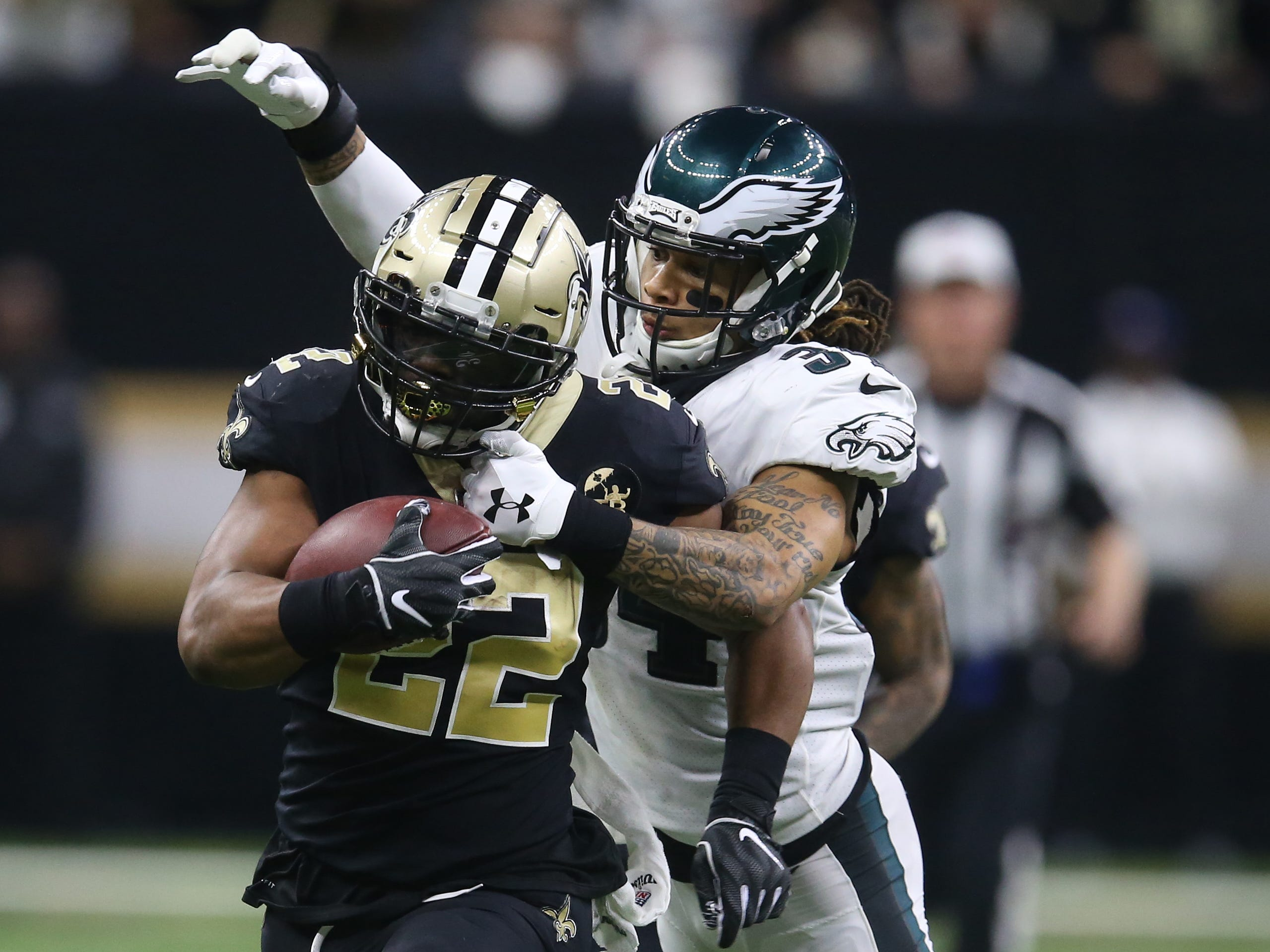 New Orleans Saints running back Mark Ingram runs against the Philadelphia Eagles during the fourth quarter of a NFC divisional playoff game at Mercedes-Benz Superdome.