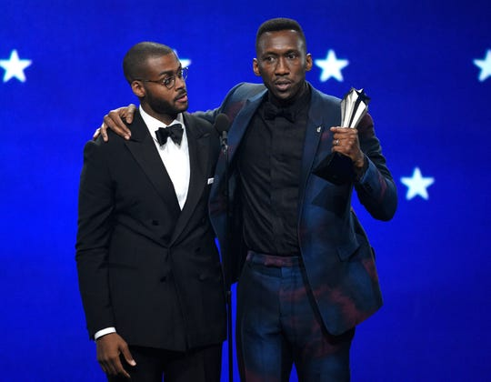 "Mahershala Ali, right, accepts the award for best supporting actor for ""Green Book"" with the film's composer and pianist Kris Bowers."