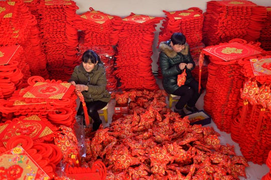 In this Jan. 10, 2019, photo from Xinhua News Agency, women make blessing decorations for the upcoming Lunar New Year in Xingtai County, north China's Hebei Province. China's trade growth slowed in 2018 as a tariff battle with Washington heated up and global consumer demand weakened.