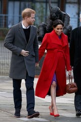 Prince Harry, Duke of Sussex and Meghan, Duchess of Sussex greet the crowd outside the Town Hall in Birkenhead, Britain, 14 January 2019.