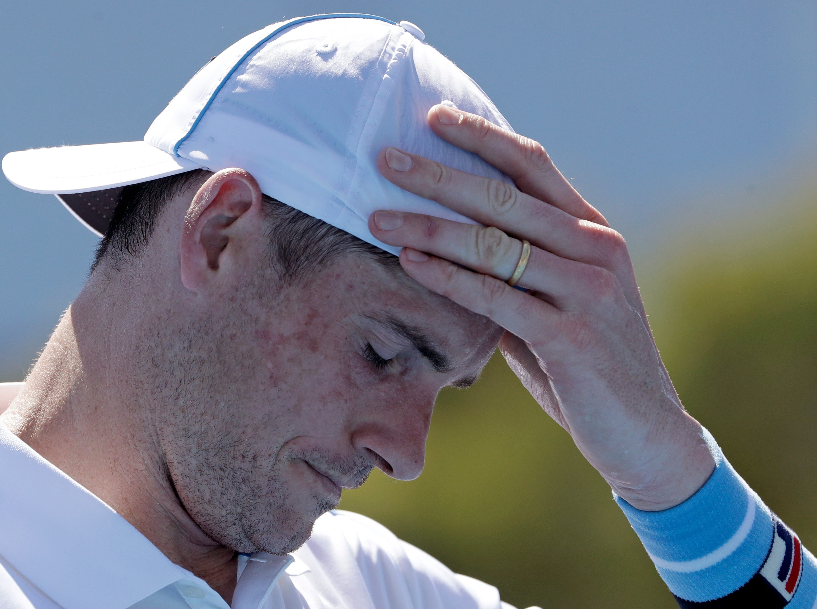 John Isner reacts during his first-round loss to Reilly Opelka.