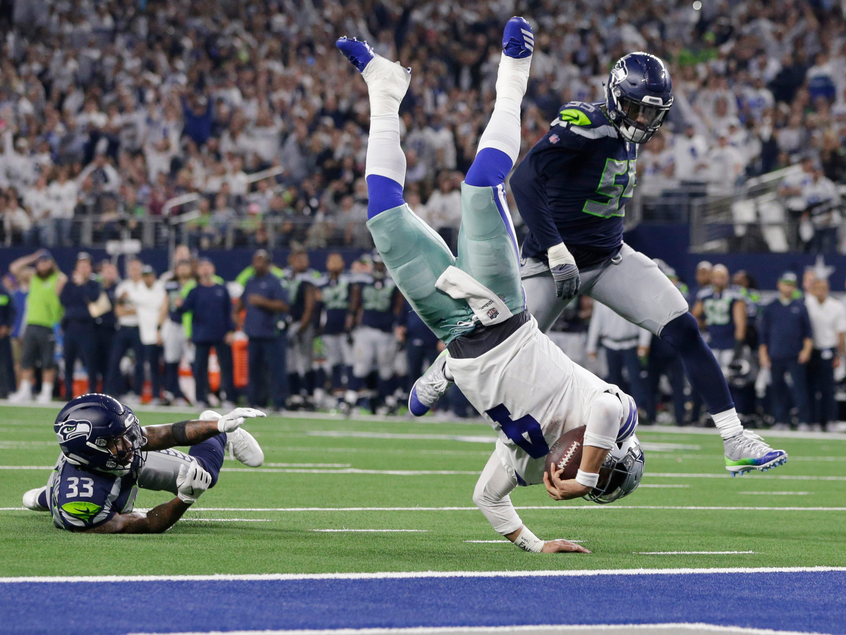 Wild-card playoffs: Dallas Cowboys quarterback Dak Prescott is tackled at the 1-yard line by Seattle Seahawks free safety Tedric Thompson (33) in the fourth quarter in the NFC wild-card playoff game at AT&T Stadium. The Cowboys won the game, 24-22.