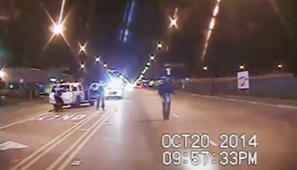 In this Oct. 20, 2014 frame from dash-cam video provided by the Chicago Police Department, Laquan McDonald, right, walks down the street moments before being fatally shot by officer Jason Van Dyke sixteen times in Chicago. A Cook County judge is expected to announce her verdict Tuesday in the conspiracy trial for three of Van Dyke's colleagues who were charged with conspiring to cover up the incident.