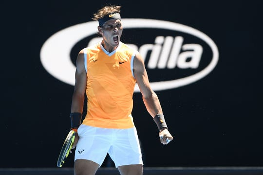 Rafael Nadal reacts after a point against James Duckworth during their men's singles match on Day 1 of the Australian Open.