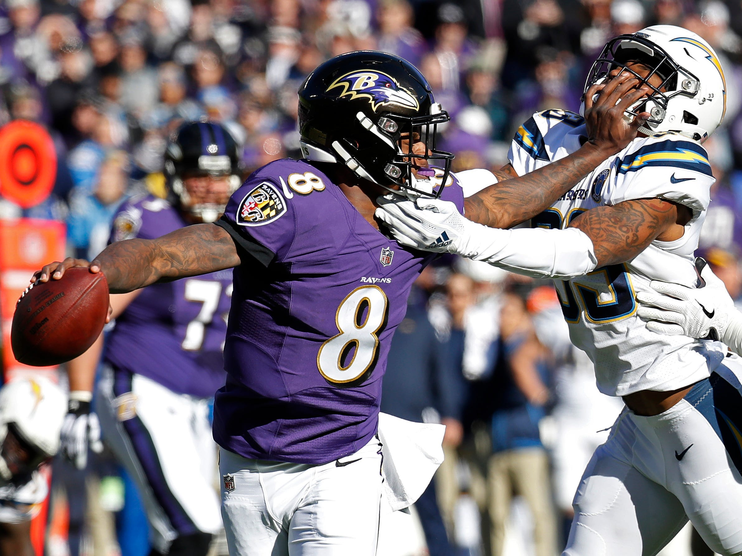 Wild-card playoffs: Baltimore Ravens quarterback Lamar Jackson scrambles from Los Angeles Chargers free safety Derwin James in the first quarter of the AFC wild-card playoff game at M&T Bank Stadium. The Chargers won the game, 23-17.