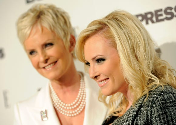 """ORG XMIT: CACP101 Columnist and author Meghan McCain, right, poses with her mother Cindy as they arrive at the ELLE and Express """"25 at 25"""" event in West Hollywood, Calif., Thursday, Oct. 7, 2010. (AP Photo/Chris Pizzello)"""