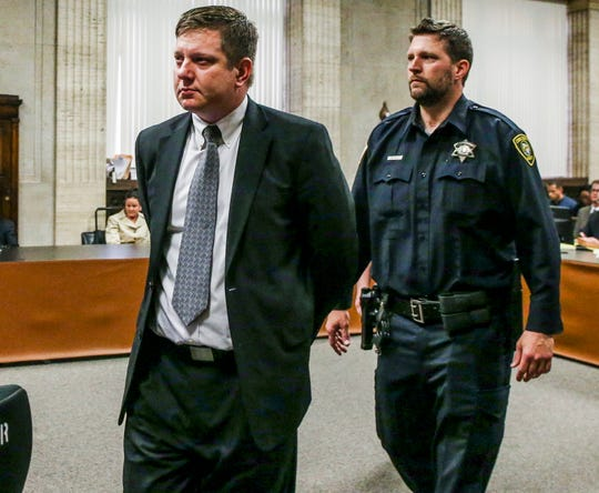 Chicago Police officer Jason Van Dyke (L) is led from the courtroom following the verdict in his trial for the 2014 shooting death of Laquan McDonald.